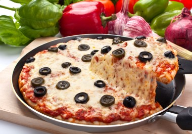 cheese and olive pizza, one slice lifted up