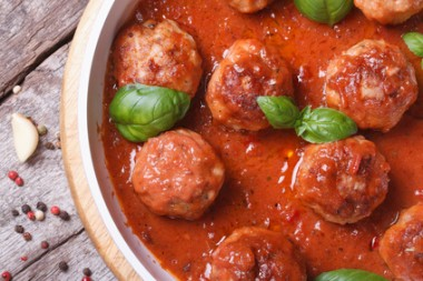 meatballs with tomato sauce and basil top view