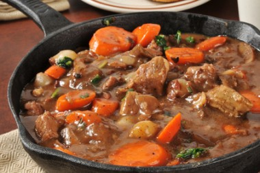 Gourmet beef stew served in a cast iron skillet