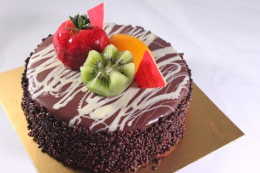 cake with chocolate glaze and strawberries