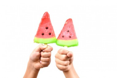 Hands holding ice cream watermelon white background