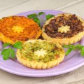 Three mini vegetarian quiches