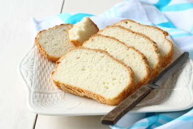 Fresh from the oven sliced gluten free bread on plate