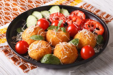 Italian arancini rice balls with cheese closeup. horizontal