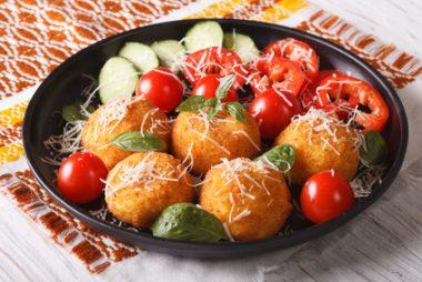 Italian arancini rice balls with cheese closeup. horizontal